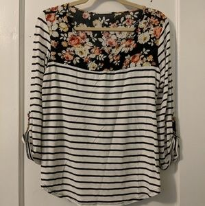 BW striped top with floral accent